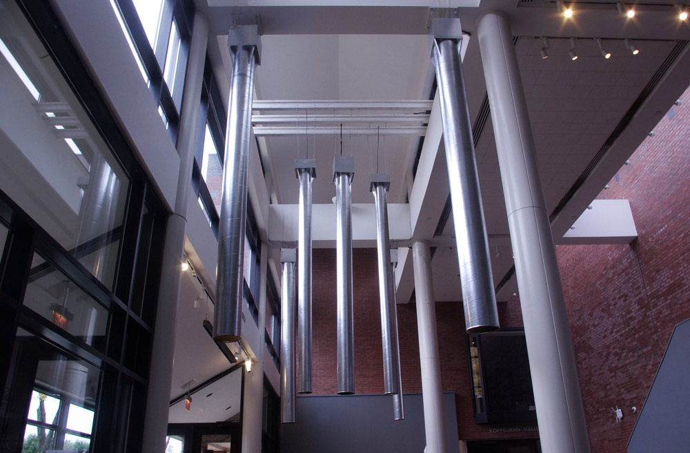 seven silver cylinders - installation view from atrium ceiling
